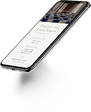 Floating mobile devices with hotel websites on screen