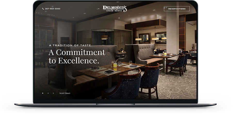 Laptop screen showing Delmonico's restaurant website