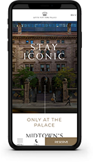 mobile device showing a beautiful hotel websites with blue beaches and lounge chairs