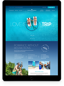 ipad showing a beautiful hotel websites with blue beaches and lounge chairs